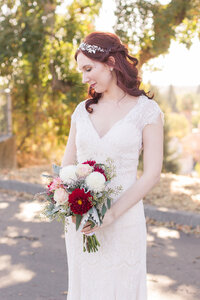A bride poses in her vintage wedding gown at her vintage inspired sacramento wedding.