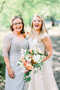 A South Carolina wedding photographer captures the mother of the bride before a Cliffs at Glassy Chapel wedding.