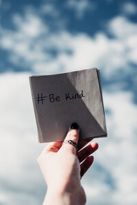 Canva - Person Holding Note with Be Kind Text