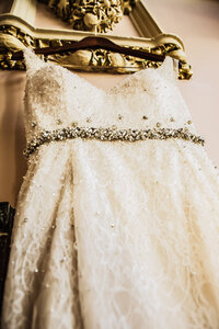Wedding Dress with rhinestone belt haning  from sconce