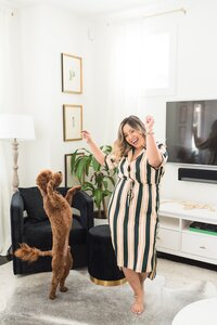 Latina business owner dancing with dog for headshots
