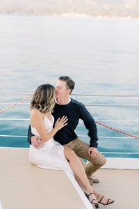 engagement photo dallas couple sitting on boat