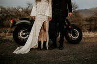eloping couple standing in front of a motorcycle