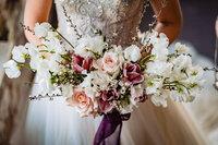 Garden-inspired bridal bouquet of sweet pea, ranunculus, brownie tulips