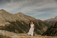 Bride and groom hugging austria alps