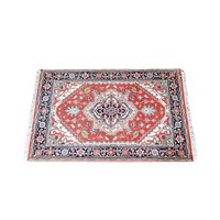 Vintage multi color rug with tasseled ends.