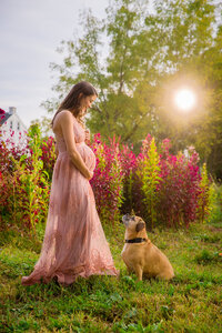 Mom-to-be with her dog at maternity session retouch