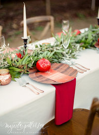 Red and Copper tablescape with wood accents at a winery in Morgan Hill