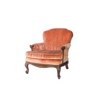 Gold velvet tufted arm chair with dark wood trim.