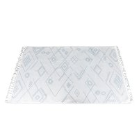 Ivory rug with blue/gray tribal design.