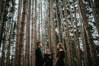 couple standing in trees