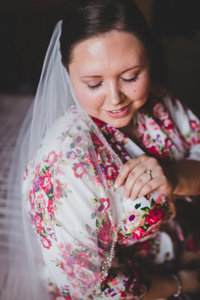 bride-floral-robe-barn-wedding