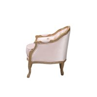 Solid oak chair with pink velvet fabric.