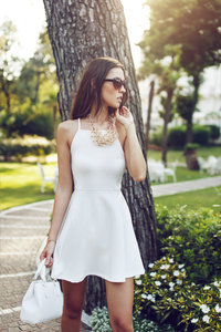 stock photo - elegant brunette white dress new york central park