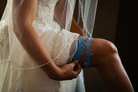 bridal-lace-garter-something-blue-wedding-dress-vermont-wedding-photographer-andy-madea-photography