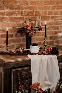 charcuterie board wedding venue candles surrounded florals
