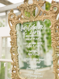 Ornate mirror covered in calligraphy at wedding