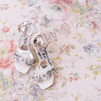 Bridal shoes detail shot on floral background