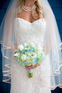 bridal bouquet with bride on blue background