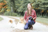Photographer sitting with dog