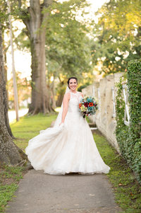 bride in a long while beautiful dress holding the back of it