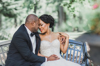 M. Harris Studios - Bride and Groom on a Park Bench