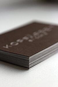 Minimal logo for Beauty brand on business card with high quality paper and silver foil emboss