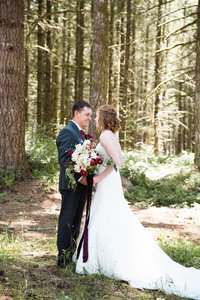 Bride and groom standing in the forrest in Oregon