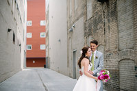 Minneapolis Wedding Photos of Bride and Groom in a bright alley