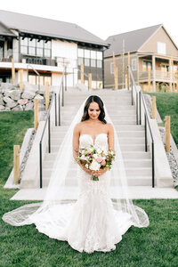 Bride walking down the aisle during Lake Chelan wedding ceremony at The Lookout