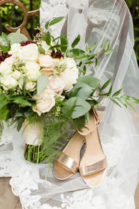 Wedding bouquet at shoes at a Gervasi Vineyard wedding photographed by akron ohio wedding photographer