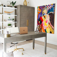 Beautiful office filled with Restoration Hardware furniture and colorful art