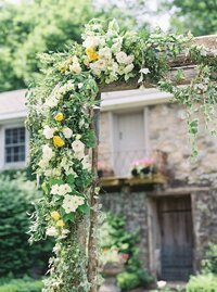 Floral design for wedding ceremony arch