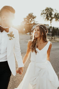 Bride and groom in white golden hour photo