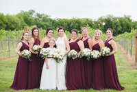 Lace bridal gown and wine bridesmaid dresses
