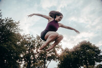 dancer jumps in air