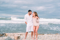 Fun couple in beach engagement photos on Long Island in Montauk engagement session captured by NYC wedding photographer Myra Roman