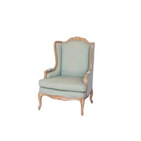 Light blue/mint wing back chair with light wood trim.
