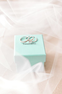 Tiffany and Co teal box with wedding rings.