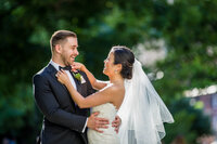 bride and groom on wedding day laughing together in a natural moment