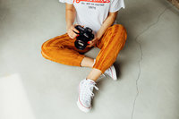 girl sitting on floor holding camera