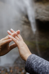 couple holding hands during latourell falls adventure session