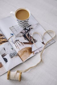 kaboompics_Coffee with a magazine