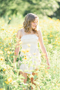 High school senior in field of yellow flowers
