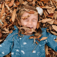 girl in autumn leaves melbourne family photography