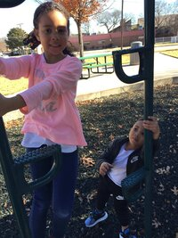 Khloe and Kyan on the playground