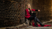 Ringmaster sitting in alley in Philadelphia for photo session