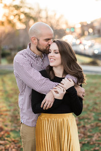 Photo of newly engaged couple in downtown Abingdon VA at sunset