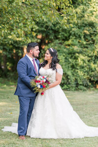 Bride and groom admire each other at their intimate Maryland backyard  wedding