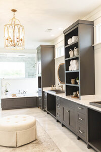 Charcoal cabinets in master bathroom renovation by Moda Designs